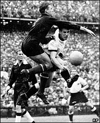 Hungarian goal keeper Gyula Grosics tries to stop an attack by West Germany's Schaefer