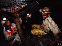 Miners working in a South African gold mine