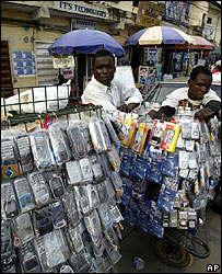 Traders display their goods and wait for people to buy telephones at the computer village market in Lagos, Nigeria