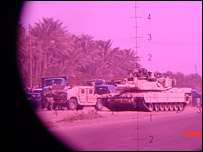 View of tank through binoculars (Photo courtesy of The War Tapes)