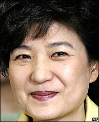 Park Geun-hye, chairwoman of the main opposition Grand National Party, smiles while she watches a live televised newscast, reporting election update at the party's headquarter in Seoul, May 31, 2006.