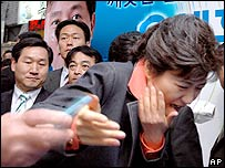Park Geun-hye, chairwoman of the Grand National Party, is attacked by an assailant with a box cutter during a campaign for the upcoming local elections in Seoul, Saturday, May 20, 2006