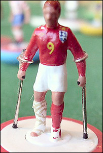 An injured Subbuteo Wayne Rooney (picture: Tom Taylor)