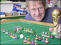 Tom Taylor with a miniature world cup (picture: Tom Taylor)