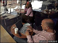 A man using a coffee shop's wireless internet connection