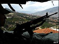 Soldiers patrol Medellin