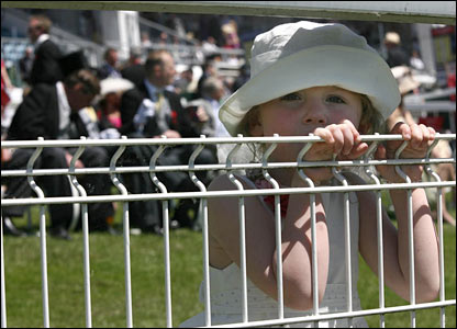 Four-year-old Megan Malloy peers through the fencing