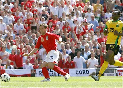 Michael Owen connects with Rio Ferdinand's ball to score and make it 4-0 at half-time