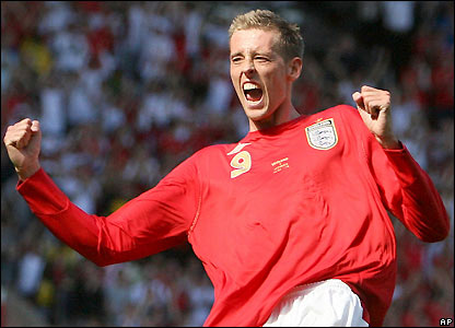Peter Crouch celebrates his first international hat-trick
