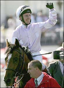 Martin Dwyer celebrates on Sir Percy