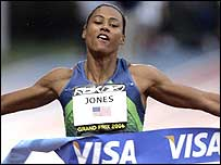 Marion Jones breaks the tape first to win in New York