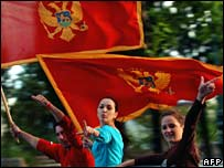 People wave flags in Podgorica
