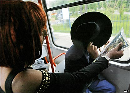 Transvestite offers gay magazine to tram passenger in Bucharest