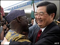 Chinese President Hu Jintao (R) is welcomed by his Nigerian counterpart Olusegun Obasanjo in April 2006