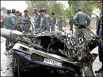 Police inspect the wreckage of the attacker's car