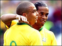 Ronaldo and Ronaldinho celebrate the opener