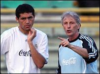 Argentina's Juan Roman Riquelme and Jose Pekerman