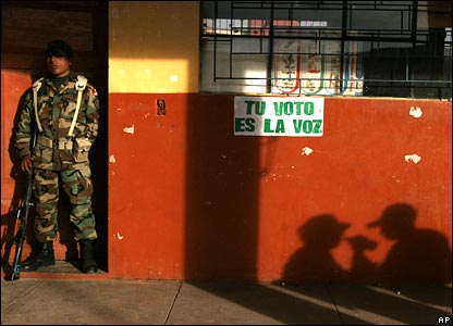 A Peruvian soldier stands guard at a voting room