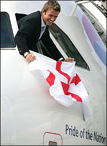 David Beckham flies the flag for England at Luton airport