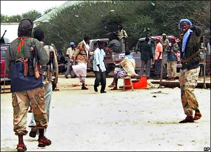 Islamic militias walk in Mogadishu's Deyniile neighbourhood after seizing it from warlord control