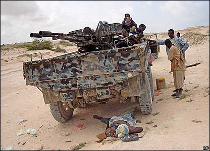 Somali militiamen with a tank they have seized from the warlords