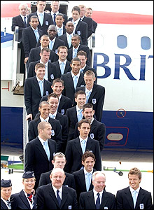 The England squad on the steps of Airbus A320 at Luton airport