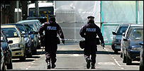 Police continue a search of the house targeted in an armed raid in Forest Gate, East London