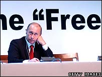 Putin reacts to a speech at the World Association of Newspapers Congress