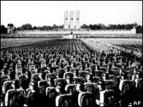 Storm troopers take part in a mass Nazi rally in Nuremberg, 1936