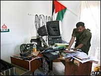 A Palestinian security official inspects the destroyed equipment of a Palestine TV