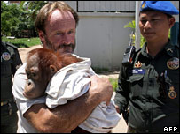 The rescued animal being held by wildlife activist Nick Marx