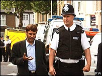 Dr Bari (left) with police at Forest Gate