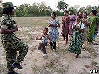 Tamil Tiger woman oversees physical training of villagers