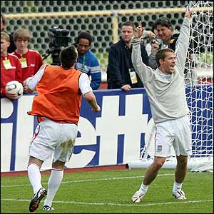 Michael Owen celebrates scoring in the training session