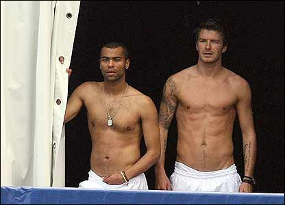 Ashley Cole and England captain David Beckham watch the training session