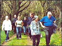 Campaigners walking through Troserch Woodland
