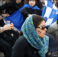 Iranian women watch football match