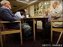 Pensioners playing dominos