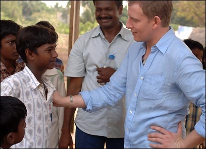 Patrick Kielty presses the flesh on a project visit