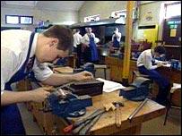 trainee filing metal