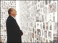 French President Jacques Chirac looks at pictures of Jews sent to camps from France at the new memorial of the Holocaust in Paris in 2005