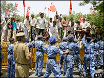 Communist Party of India activists shout slogans against government