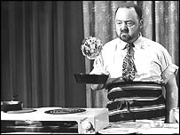 A resolute-looking Philip Harben flips a pancake