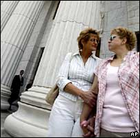 Kathy Burke, left, and Tonja Alois of Rotterdam, N.Y, wait outside New York State's highest court
