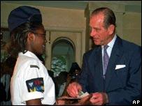 The Prince presenting a Duke of Edinburgh Gold Award in Jamaica in 1998