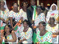Mothers of the Ivorian national football team wearing their medals