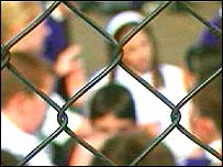 School children viewed through a fence
