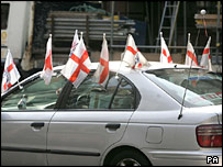 Car with 10 England flags