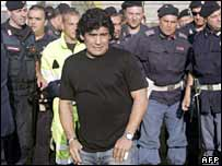 Diego Maradona near Naples, wearing two watches on his wrists