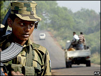 Tamil Tiger rebels patrol a highway